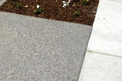 Nice Aggregate Finish Adjacent To Gray Brushed Concrete Finish